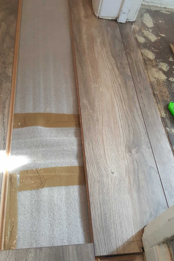 Jamb Saw Used And Laminate Board Cut To Fit.